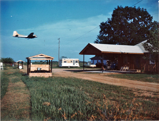 Conyers Farmhouse with low flying plane
